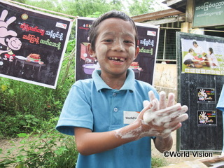 a boy participated in global hands washing day activity conductrd by WV (Myammer)