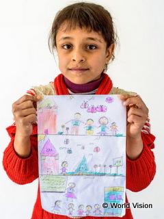 シリアでの暮らしを思い出して絵を描いた少女